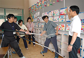Teachers practice using Sasumata at school